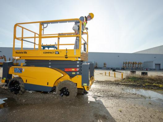 Compact 12 DX electric rough terrain scissor lifts